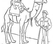 Coloriage Le pèere guide le chameau