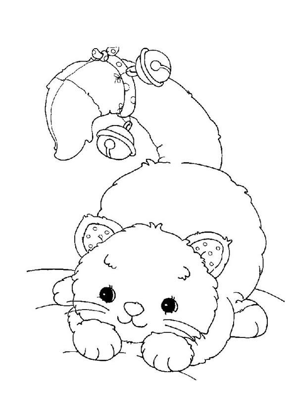 Coloriage et dessins gratuits Chaton sur le lit à imprimer