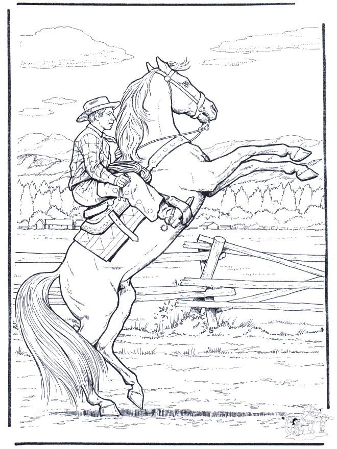 Coloriage et dessins gratuits Cowboy et son cheval cabré à imprimer