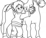 Coloriage et dessins gratuit Une fille prend soin de Poney à imprimer
