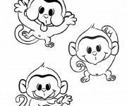 Coloriage Les petits singes en jouant