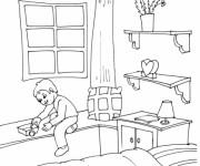 Coloriage Le garçon joue dans sa Chambre