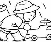 Coloriage et dessins gratuit garçon joue sous la pluie d'automne à imprimer