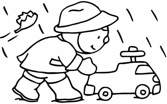 Coloriage et dessins gratuits garçon joue sous la pluie d'automne à imprimer