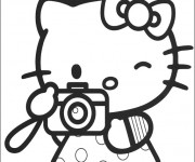 Coloriage et dessins gratuit Hello Kitty prend une photo à imprimer