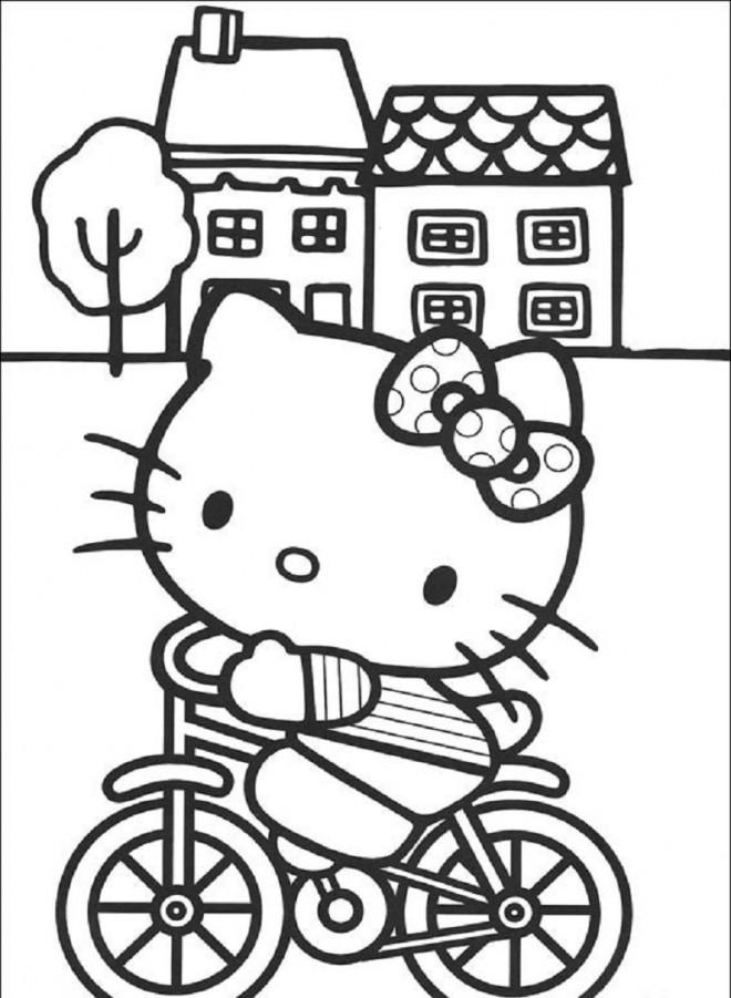 Coloriage et dessins gratuits Minou sur Bicyclette à imprimer