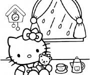 Coloriage Hello Kitty boit du thé