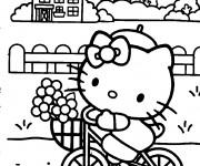 Coloriage Hello Kitty se promène en bicyclette