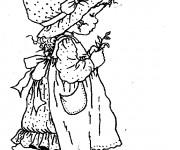 Coloriage Sarah Kay tient une petite plante