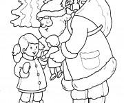 Coloriage Père Noël offre un cadeau à une petite fille