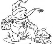 Coloriage Winny content d'avoir un cadeau de Noël