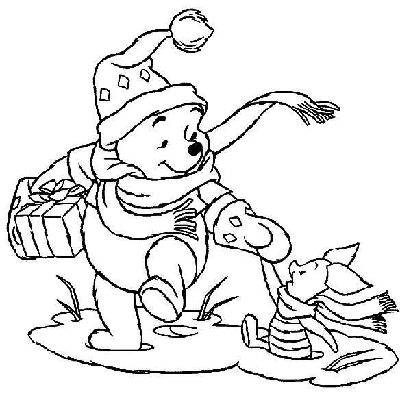 Coloriage et dessins gratuits Winny content d'avoir un cadeau de Noël à imprimer