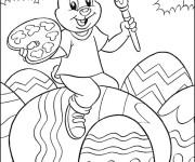 Coloriage Lapin décore les Oeufs de Pâques