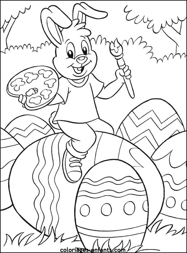 Coloriage et dessins gratuits Lapin décore les Oeufs de Pâques à imprimer