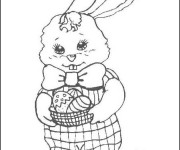 Coloriage Lapine avec panier d'oeuf de  Pâques dans ses mains