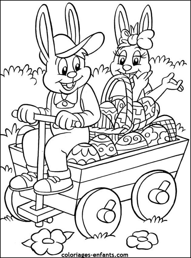 Coloriage et dessins gratuits Les Lapins délivrent les Oeufs de Pâques à imprimer
