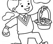 Coloriage Un Garçon porte un panier d'oeufs de Pâques