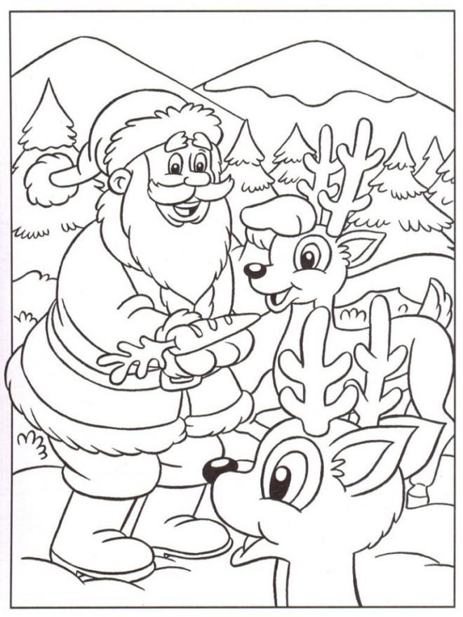 Coloriage et dessins gratuits Le père Noël nourrit ses rennes à imprimer