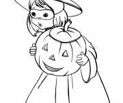 Coloriage Petite fille d'halloween avec sa citrouille
