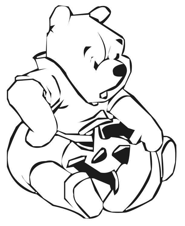 Coloriage et dessins gratuits Winnie prépare sa citrouille à imprimer
