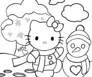Coloriage Hello Kitty s'amuse dans le jardin