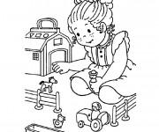 Coloriage Une Fille et ses Jouets Maternelle