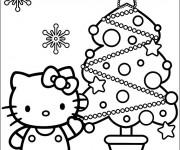 Coloriage et dessins gratuit Hello Kitty et Le Sapin de Noël à imprimer