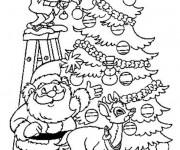 Coloriage Père Noël décore le Sapin