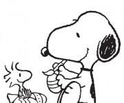 Coloriage et dessins gratuit Snoopy décore les Oeufs à imprimer