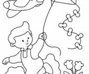 Coloriage et dessins gratuit Enfant avec le Cerf-Volant à imprimer