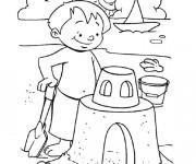 Coloriage et dessins gratuit Enfant construit son Château de Sable à imprimer