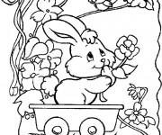 Coloriage Un Lapin qui porte des fleurs