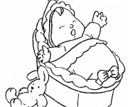 Coloriage Bébé dormant près de son lapin