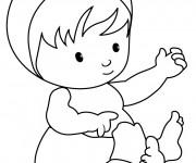 Coloriage et dessins gratuit Bébé en jouant avec ses mains à imprimer