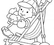 Coloriage et dessins gratuit Bébé et ses jouets à imprimer