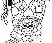 Coloriage Un clown acrobate en équilibre sur ses mains