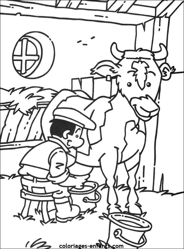 Coloriage et dessins gratuits Fermier trait la vache à imprimer