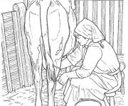Coloriage et dessins gratuit Fermière et vache à imprimer