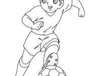 Coloriage Un jeune joueur de foot