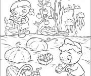 Coloriage Les enfants récoltent les légumes