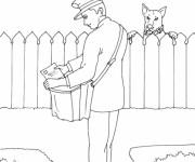 Coloriage Un chien méchant regarde le facteur apportant le courrier