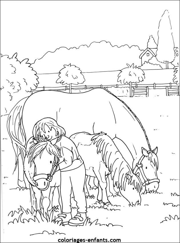 Coloriage et dessins gratuits La fillette et la famille de chevaux à imprimer