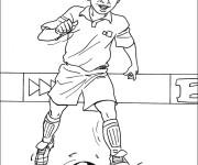 Coloriage Joueur de foot sur le terrain