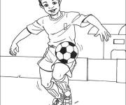 Coloriage Joueur dribble le ballon