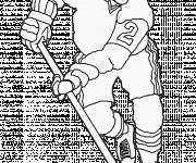 Coloriage et dessins gratuit Joueur de Hockey en attaque à imprimer