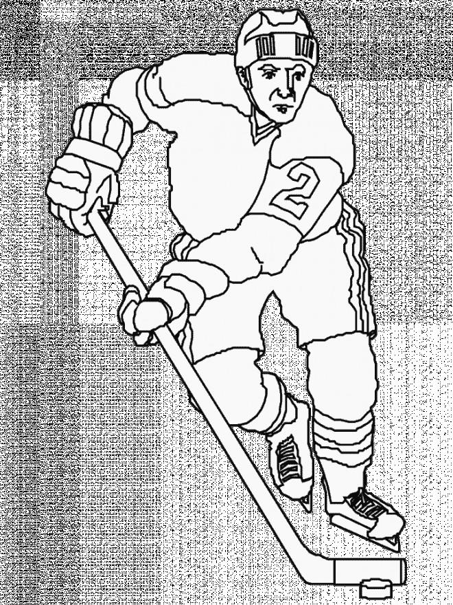 Coloriage et dessins gratuits Joueur de Hockey en attaque à imprimer