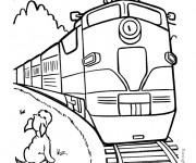 Coloriage Train passe devant le chien