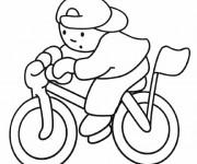 Coloriage Le garçon sur sa  Bicyclette